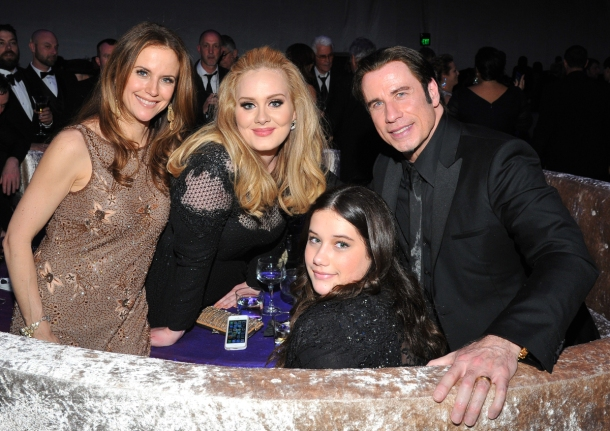 With John Travolta, his daughter and wife, Kelly Preston