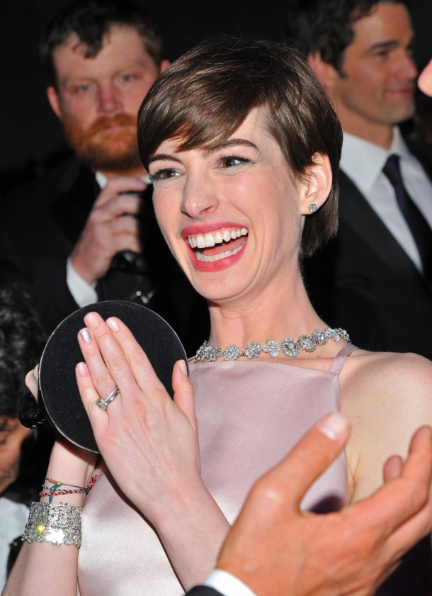 Anne Hathaway is clearly finding something hysterical
