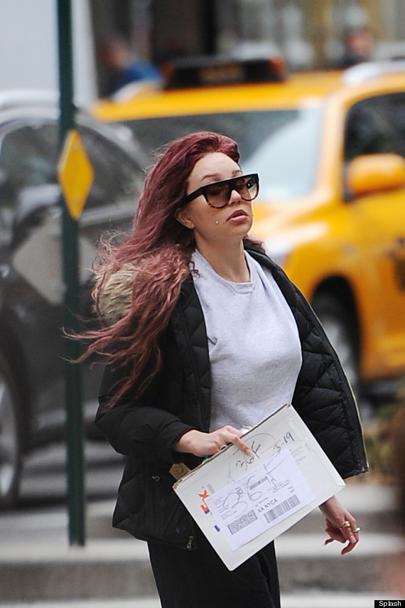 EXCLUSIVE: Amanda Bynes seen out in NYC running errands, debuting her new red hair color